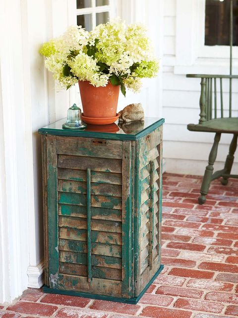 Furniture, Turquoise, Table, Chest of drawers, Room, Plant, Flowerpot, Tile, Nightstand, Flower,