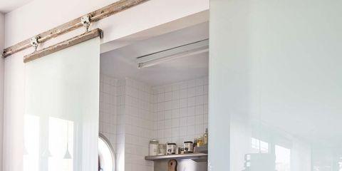 Room, Interior design, Ceiling, Wall, Fixture, Interior design, Light fixture, Houseplant, Molding, Cabinetry,