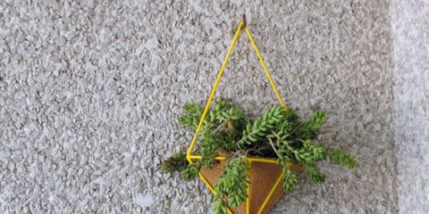 Green, Leaf, Triangle, Symmetry, Creative arts, Symbol, Craft,