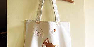 Bag, Corded phone, Flowerpot, Shoulder bag, Telephone, Telephony, Bouquet, Tote bag, Home accessories, Cut flowers,