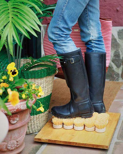 Flowerpot, Denim, Jeans, Riding boot, Boot, Knee-high boot, Street fashion, Pocket, Sculpture, Houseplant,