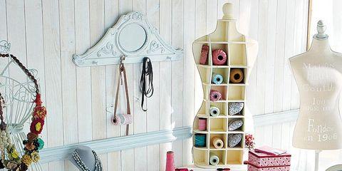 Room, Interior design, Mannequin, Desk, Peach, Shelving, Collection, Home accessories, Lamp, Fashion design,