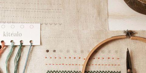 Textile, Line, Beige, Circle, Craft, Cutting tool,