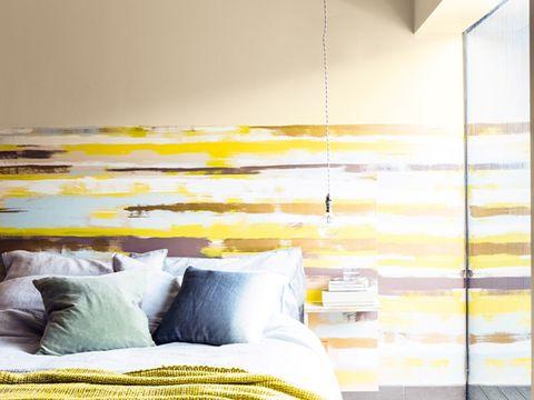 Yellow, Room, Interior design, Textile, Wall, Linens, Bedding, Pillow, Throw pillow, Bedroom,