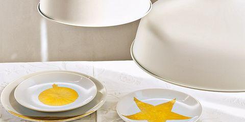 Serveware, Yellow, Dishware, Porcelain, Ceramic, Home accessories, Kitchen utensil, Cup, Symbol, Teacup,