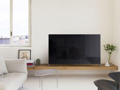 Room, Interior design, Floor, Wall, Furniture, Flooring, Interior design, Living room, Couch, Display device,