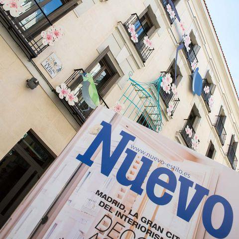 Facade, Commercial building, Advertising, Mixed-use, Urban design, Balcony, Apartment, Door, Publication, Banner,