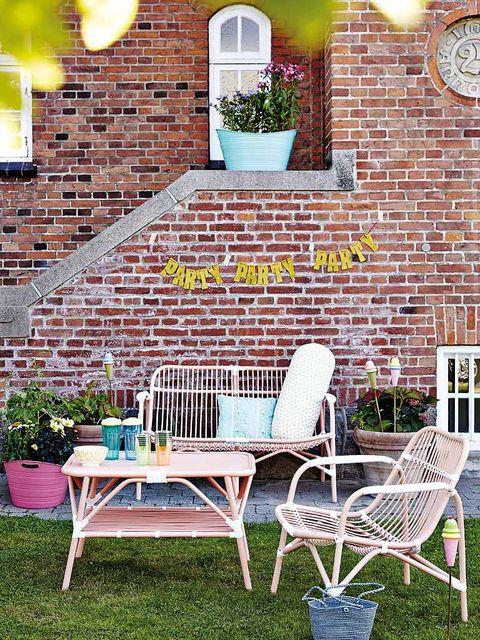 Furniture, Outdoor furniture, Table, Chair, Brick, Flowerpot, Outdoor table, Wall clock, Home, Brickwork,