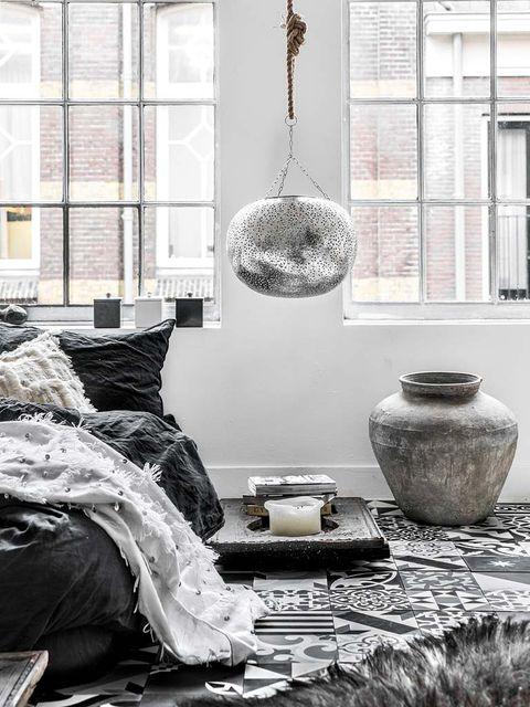 Room, Interior design, Serveware, Wall, Linens, Interior design, Grey, Monochrome photography, Pillow, Light fixture,
