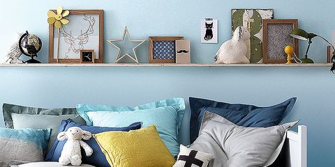 Blue, Room, Yellow, Textile, Wall, Bedding, Home, Interior design, Furniture, Pillow,