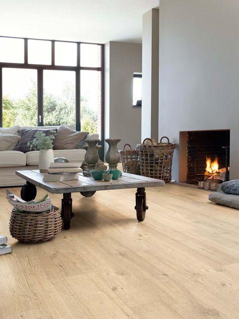 Laminate flooring, Floor, Living room, Wood flooring, Room, Flooring, Furniture, Interior design, Coffee table, Tile,