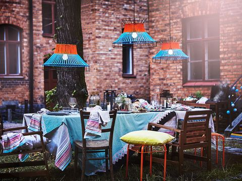 Urban area, Wall, Turquoise, Table, Furniture, Brick, Tree, Umbrella, Architecture, Building,