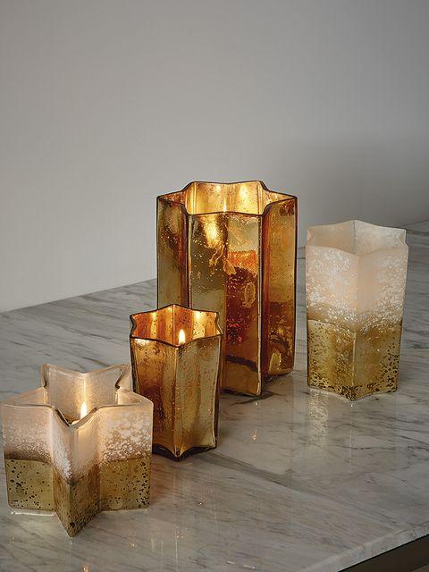 Lighting, Candle holder, Candle, Still life photography, Interior design, Cylinder, Light fixture,