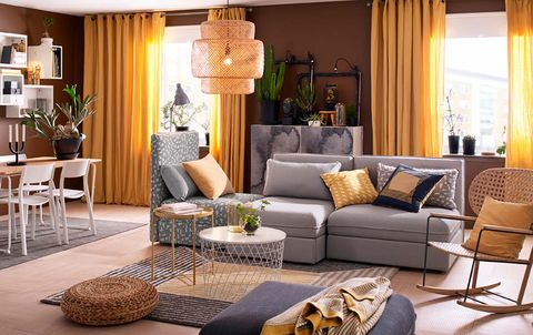 Living room, Furniture, Room, Interior design, Coffee table, Couch, Property, Table, Yellow, Brown,