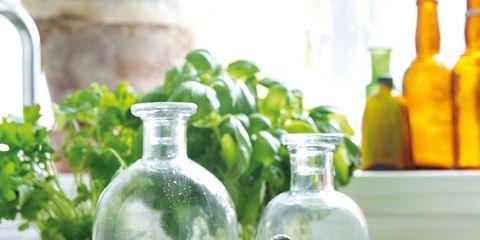 Yellow, Bottle, Glass bottle, Citrus, Glass, Lemon, Fruit, Drinkware, Liquid, Meyer lemon,
