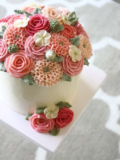 Buttercream, Bouquet, Icing, Flower, Cake decorating, Pink, Cake, Sugar paste, Food, Plant,