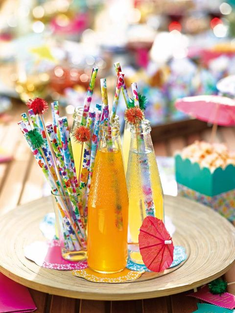 Bottle, Table, Party supply, Peach, Glass bottle, Juice, Drinking straw,