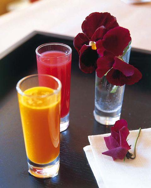 Petal, Flower, Drink, Juice, Glass, Flowering plant, Tableware, Cut flowers, Carmine, Centrepiece,