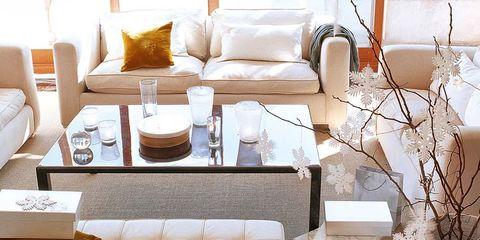 Room, Interior design, Textile, Living room, Furniture, Wall, Interior design, Twig, Throw pillow, Pillow,