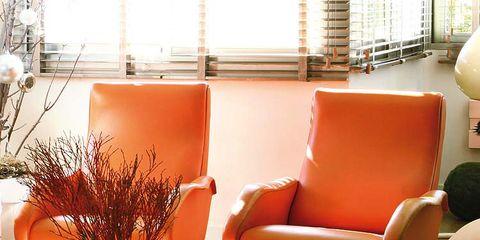 Room, Interior design, Furniture, Orange, Floor, Interior design, Flooring, Window covering, Hardwood, Centrepiece,