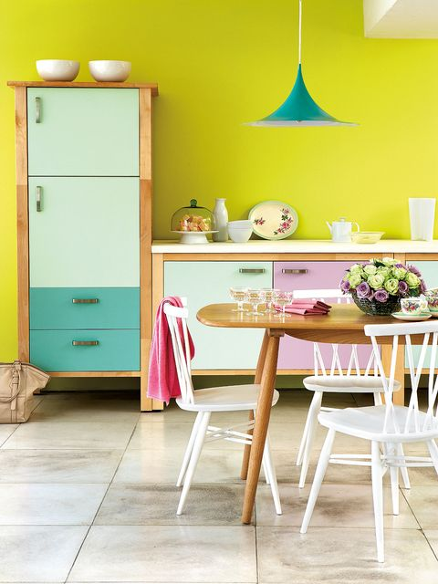 Yellow, Room, Furniture, Floor, Interior design, Table, Flooring, Cabinetry, Interior design, Cupboard,