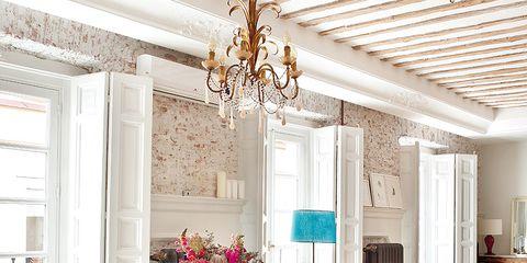 Room, Interior design, Floor, Table, Furniture, Light fixture, Ceiling, Chandelier, Flooring, Ceiling fixture,