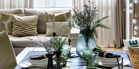 Green, Room, Interior design, Table, Porcelain, Christmas decoration, Tree, Living room, Tableware, Furniture,