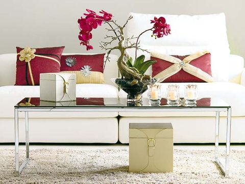 Room, Interior design, Petal, Furniture, White, Red, Interior design, Table, Living room, Pillow,