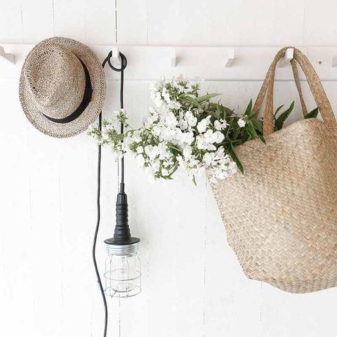Hat, Petal, Still life photography, Sun hat, Beige, Home accessories, Flower Arranging, Floral design, Cut flowers, Fedora,