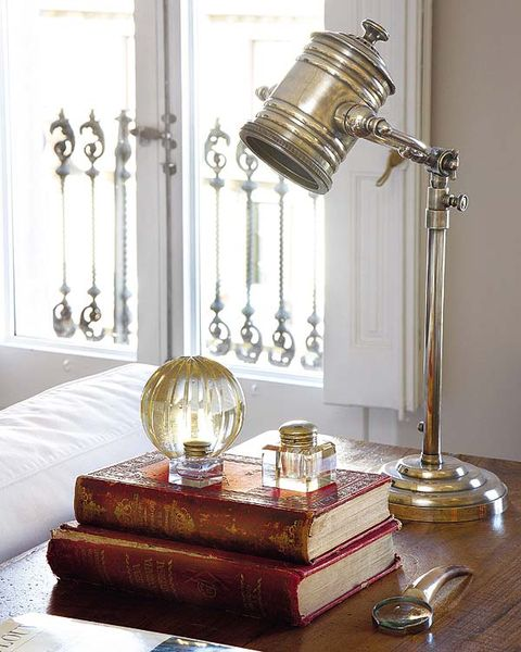 Room, Metal, Brass, Lamp, Interior design, Home accessories, Still life photography, Cylinder, Bronze, Living room,