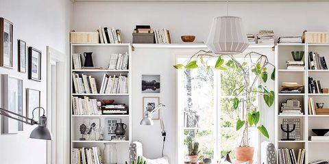 Room, Interior design, Home, Living room, Floor, White, Flooring, Wall, Furniture, Shelving,