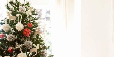 Human, Interior design, Room, Christmas decoration, Christmas tree, Home, Interior design, Living room, Holiday, Christmas ornament,