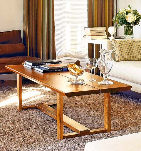 Room, Interior design, Table, Furniture, Living room, Couch, Coffee table, Floor, Interior design, Flooring,