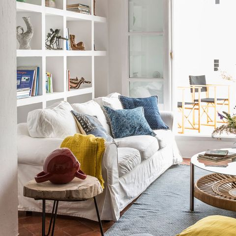 Blue, Room, Interior design, Home, Furniture, Wall, Living room, White, Couch, Pillow,