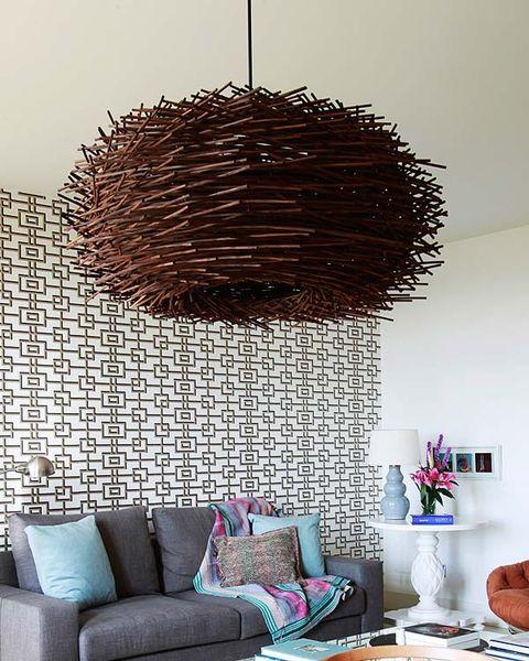 Room, Interior design, Living room, Wall, Furniture, Couch, Interior design, Pillow, Flowerpot, Purple,