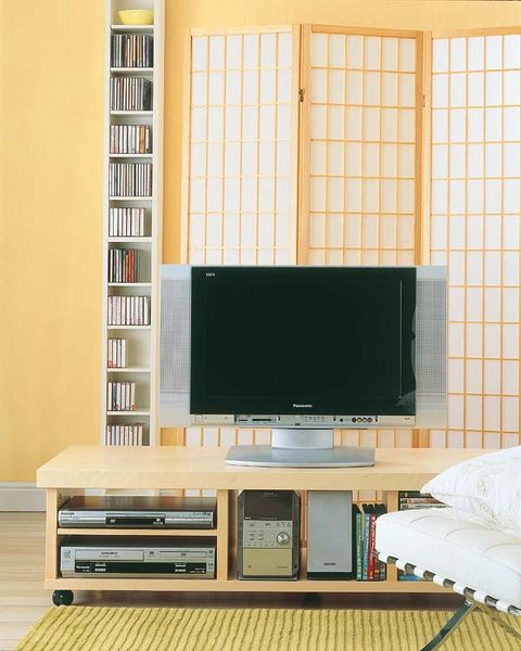 Electronic device, Room, Display device, Interior design, Electronics, Television set, Home appliance, Television, Entertainment center, Shelf,