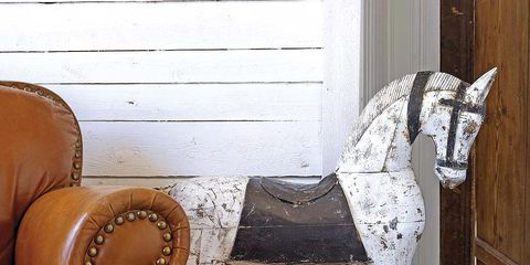 Brown, Wall, Horse, Interior design, Sculpture, Grey, Tan, Living room, Armrest, Club chair,