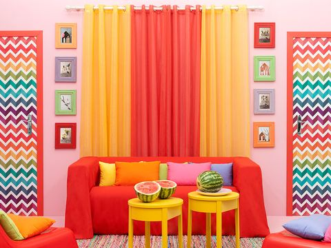 Room, Interior design, Yellow, Green, Orange, Furniture, Textile, Living room, Wall, Colorfulness,