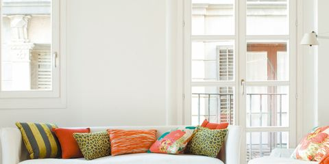 Room, Interior design, Orange, Home, Living room, Wall, Furniture, Couch, Pillow, Throw pillow,