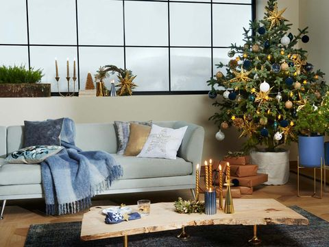 Living room, Room, Blue, Christmas tree, Christmas decoration, Furniture, Home, Couch, Interior design, Tree,