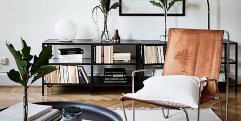 Furniture, Living room, Room, Coffee table, Interior design, Table, Wall, Black-and-white, Floor, Material property,