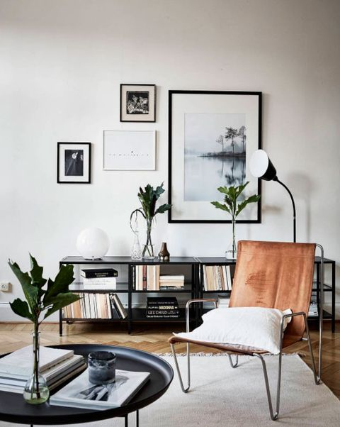Living room, Furniture, Room, Coffee table, Interior design, Table, Wall, Black-and-white, Building, Home,