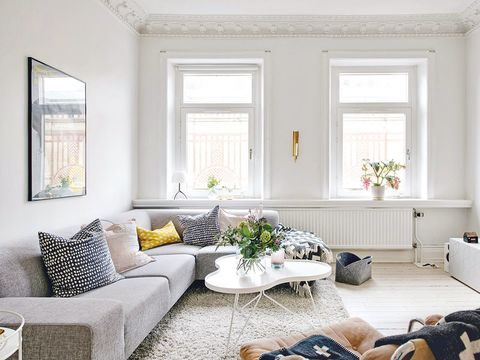 Living room, Room, White, Furniture, Interior design, Property, Couch, Coffee table, Home, Yellow,
