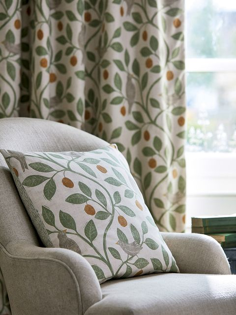 Furniture, Curtain, Living room, Interior design, Room, Couch, Slipcover, Wall, Chair, Textile,