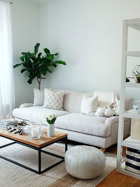 Living room, Furniture, Room, White, Interior design, Coffee table, Table, Floor, Couch, studio couch,