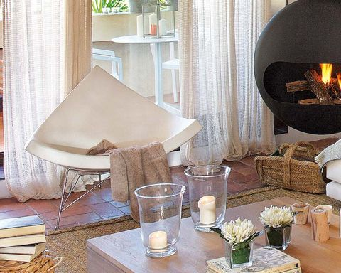 Room, Interior design, Textile, Table, Linens, Interior design, Hearth, Lamp, Home, Heat,