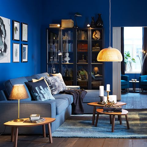 Blue, Living room, Room, Furniture, Interior design, Lighting, Table, Coffee table, Wall, Couch,