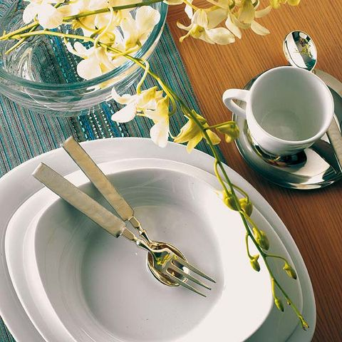 Serveware, Coffee cup, Dishware, Yellow, Cup, Drinkware, Porcelain, Tableware, Table, Teacup,