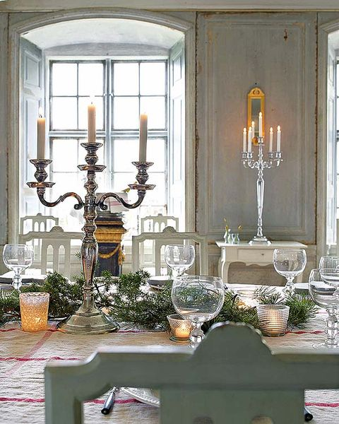 Room, Interior design, Interior design, Candle holder, Glass, Light fixture, Candle, Chandelier, Cutlery, Natural material,