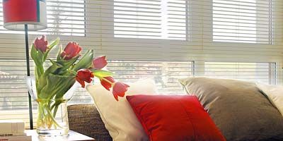 Room, Interior design, Wood, Property, Textile, Window covering, Red, Wall, Furniture, Flower,